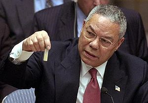 At the UN, Colin Powell holds a model vial of ...