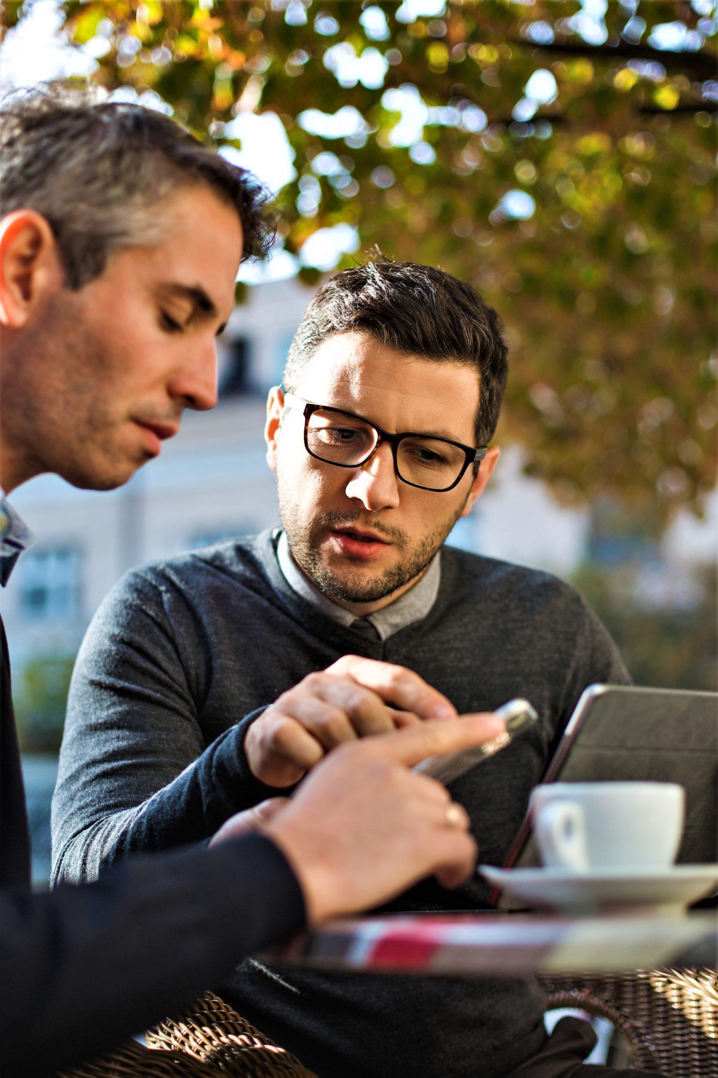 Two Businessmen people having a coffee break