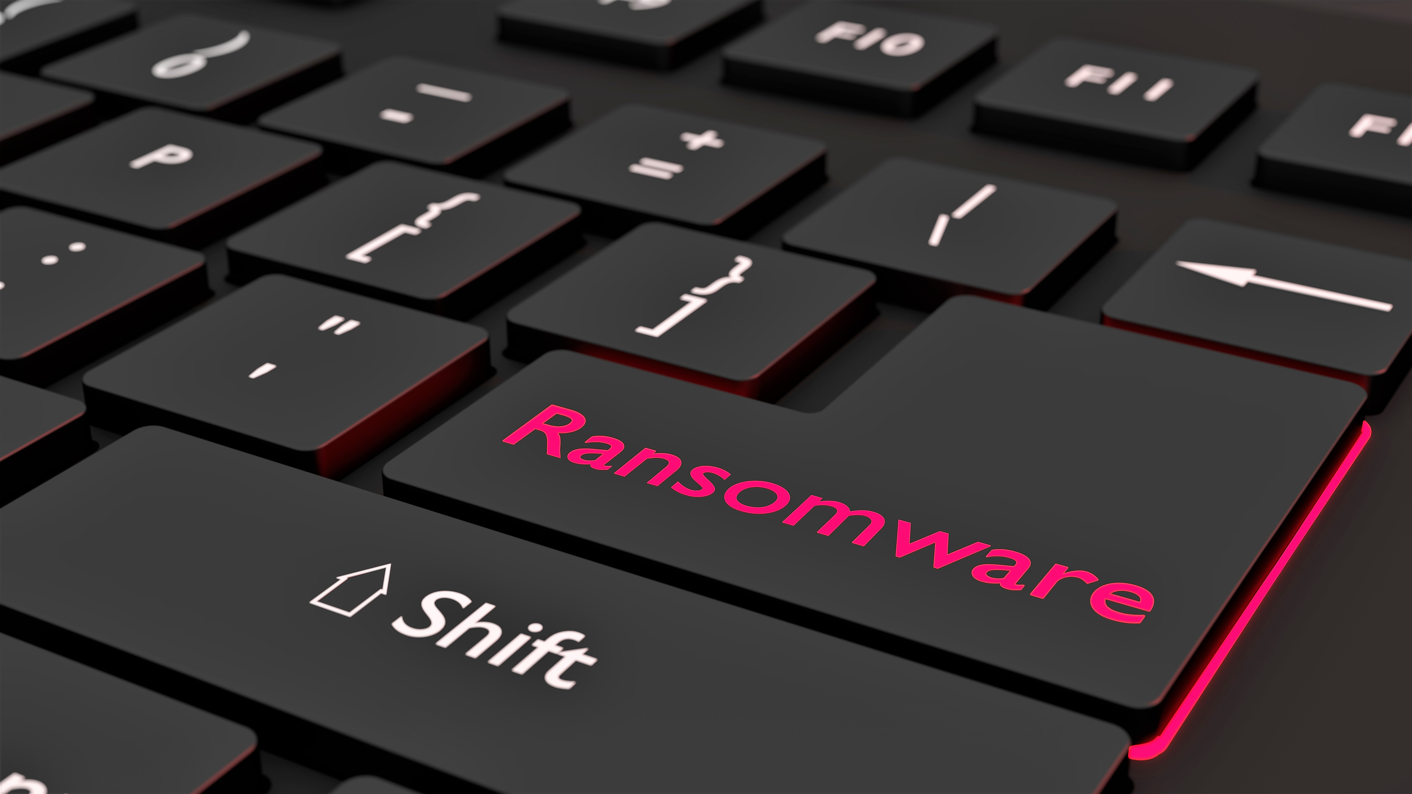 Black ransomware keyboard cybersecurity concept