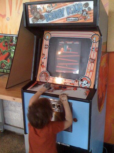 Kid plays Donkey Kong